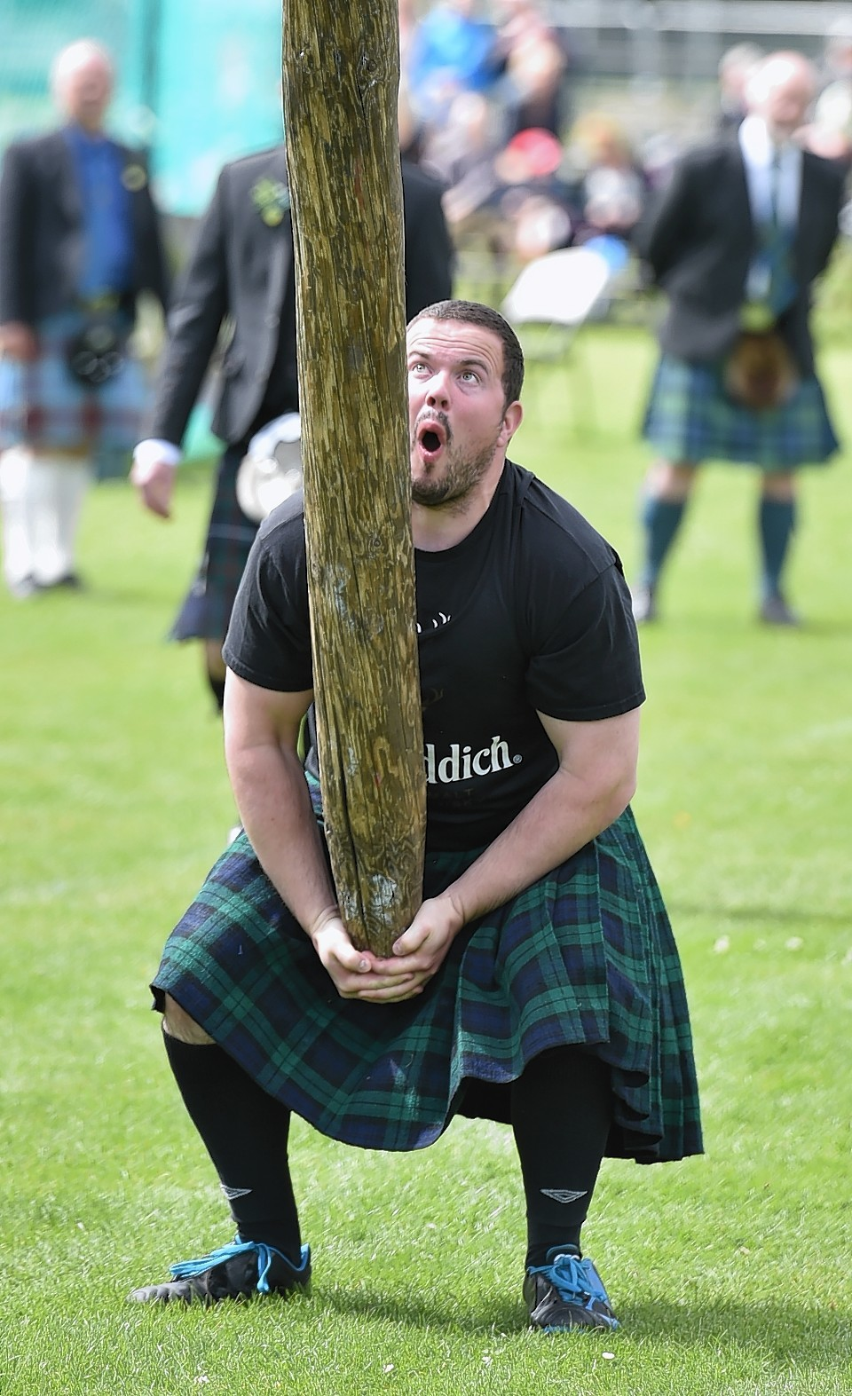Aboyne Highland Games - Throwing the caber - Dale Walker. Picture by COLIN RENNIE