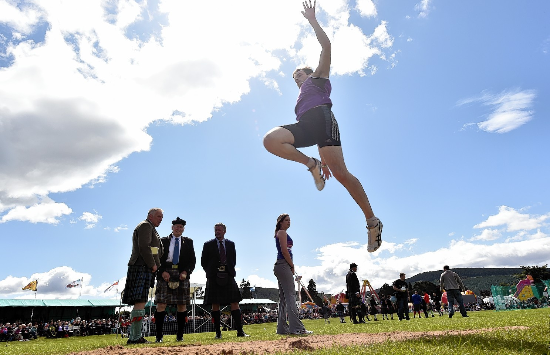 Aboyne Highland Games - The long jump Sam Lyon from Aberdeen.