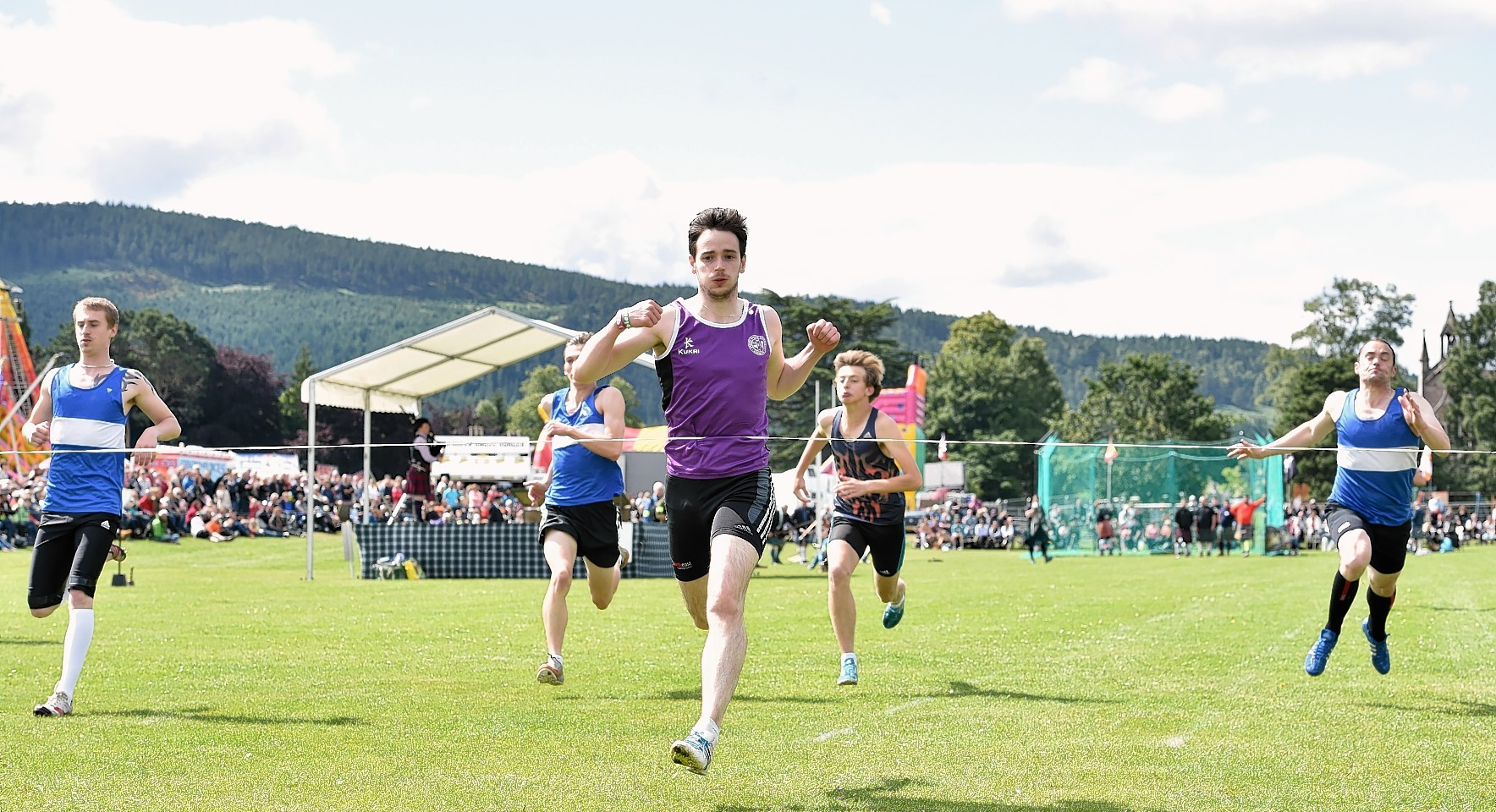 Aboyne Highland Games - winner of the 100 yard race - Sam Lyon from Aberdeen. Picture by COLIN RENNIE