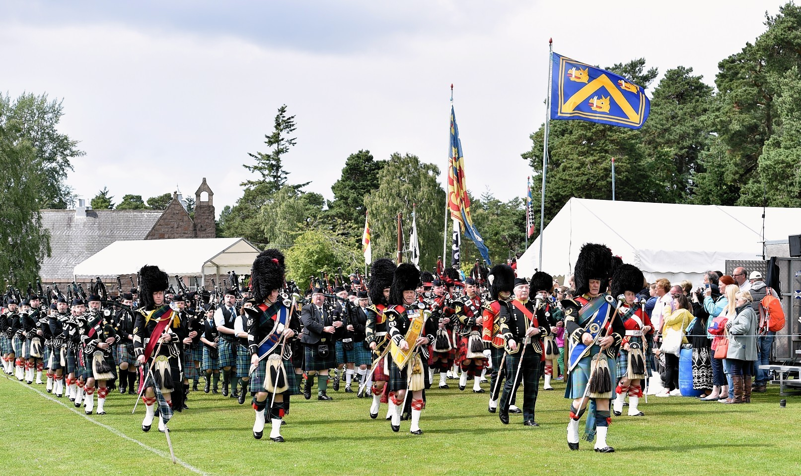 Aboyne Highland Games - The mass pipe bands. Picture by COLIN RENNIE