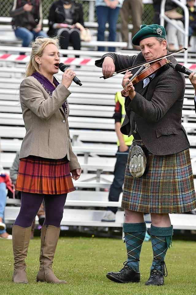 Aboyne Highland Games - Paddy Arthur and Paul Anderson at the opening ceremony. Picture by COLIN RENNIE