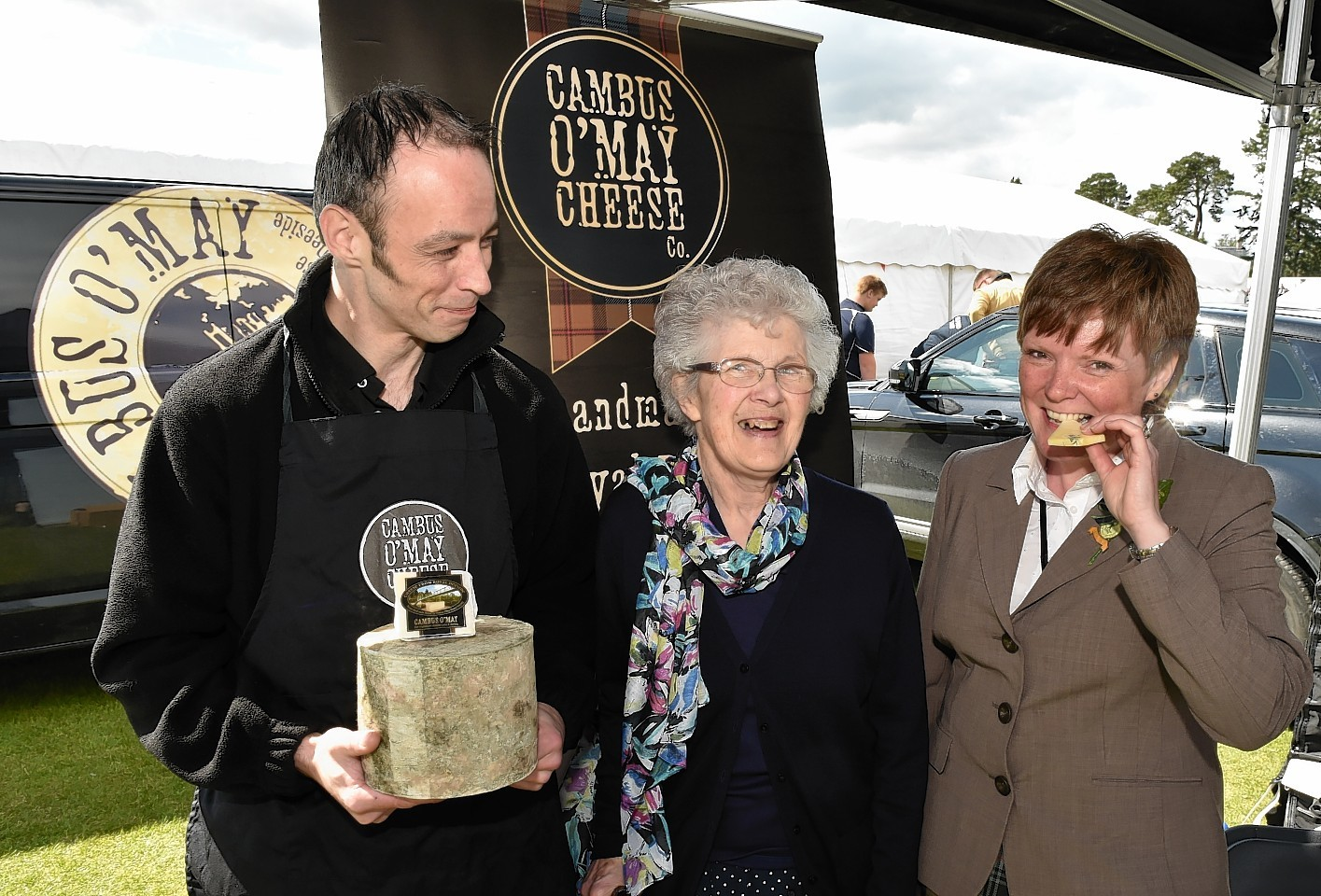 Aboyne secretary Morag McBeath (right) with cheesemaker James Reid and Barbara Reid. Picture by Colin Rennie