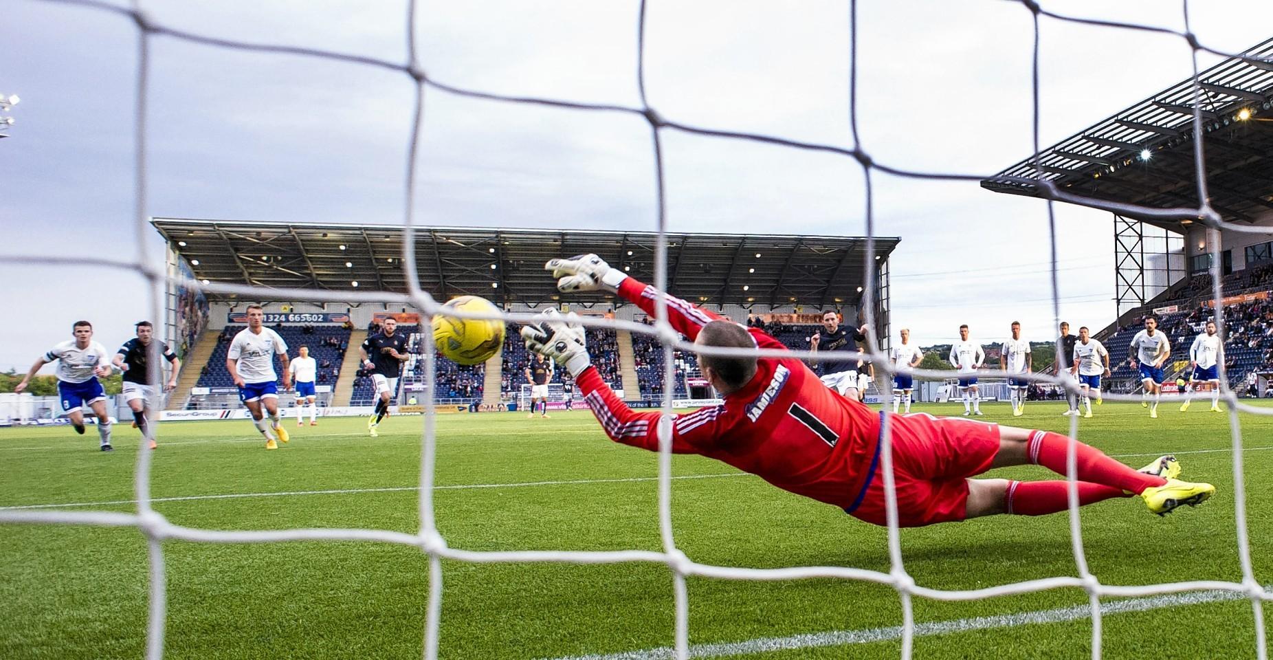 Peterhead goalkeeper Graeme Smith  in action