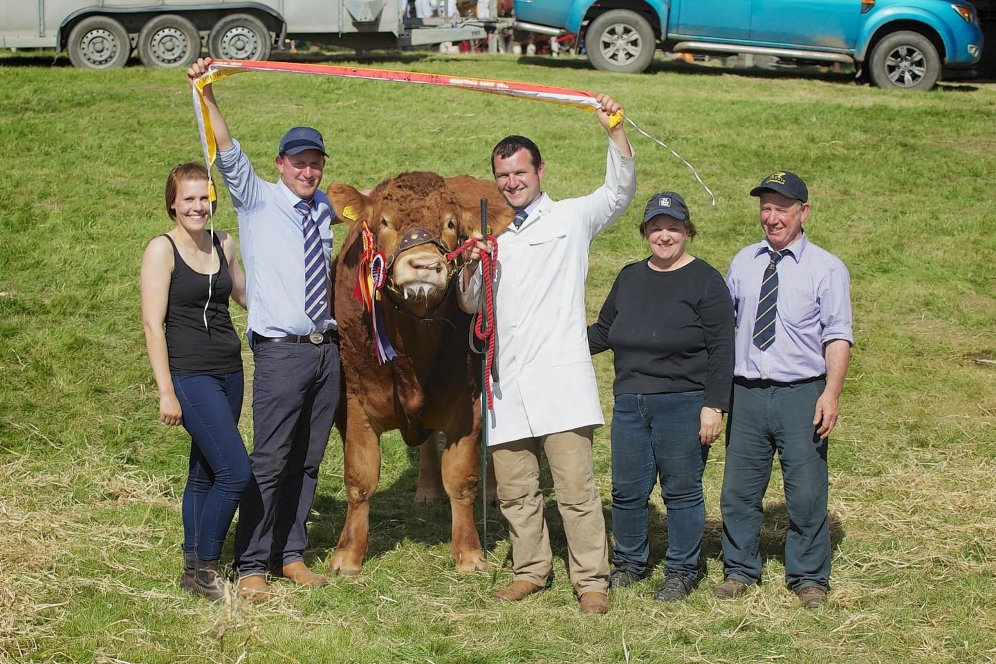 The Irvine family celebrates with the champion bull