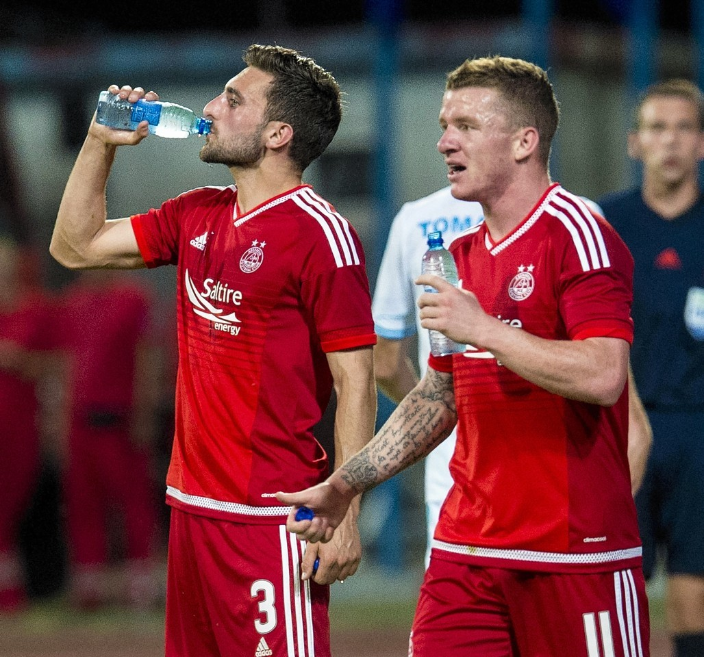 Hayes (right) has been impressed with the way Shinnie (left) has taken to life at Aberdeen