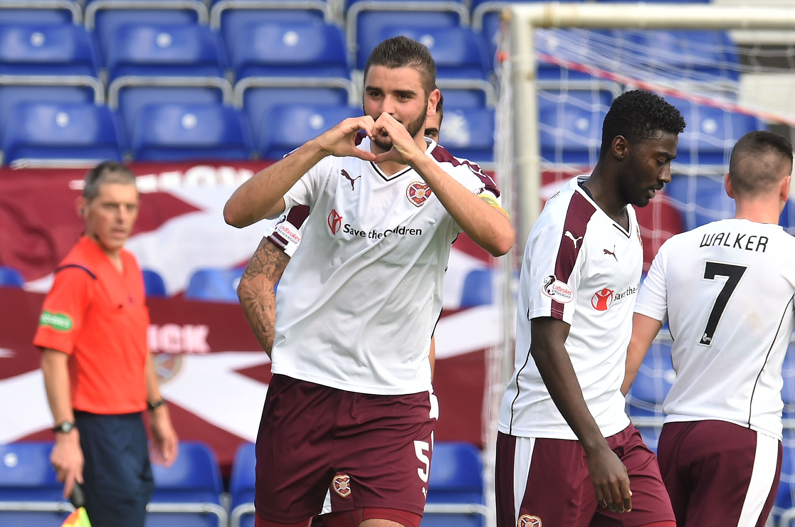 Alim Ozturk celebrates after scoring to give Hearts a two-goal lead