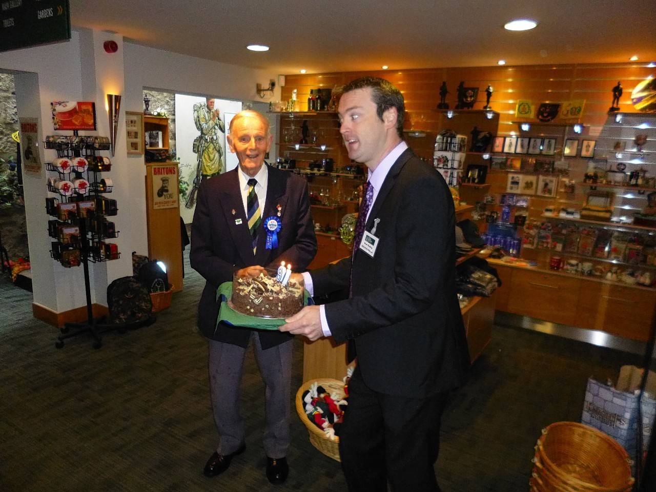 Jim Glennie receives his 90th birthday cake from museum executive director, Bryan Snelling.