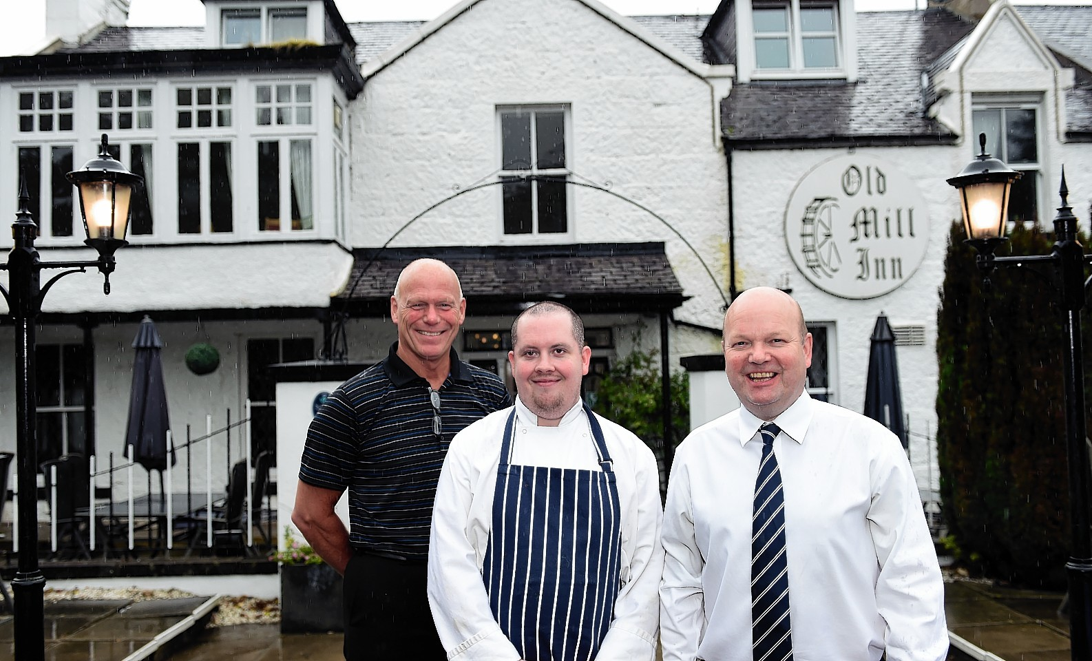 The Old Mill Inn, Maryculter, has reopened after almost a year.     Pictured - Owners Vic Sang (left) and Mike French (right) with head chef Darren McKay (middle) at the inn on it's first day back open.   Picture by Kami Thomson