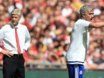 Arsene Wenger, left, suggested a lack of respect was behind his decision to snub Jose Mourinho