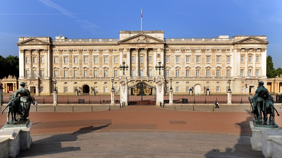 The activists scaled the roof of Buckingham Palace