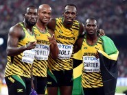 Usain Bolt, second right, anchored Jamaica to 4x100 metres gold in Beijing