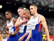 Great Britain's men's 4x100m relay team are disconsolate after failing to finish in the final at the World Championships