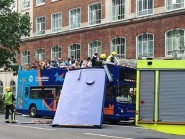 The bus had its roof ripped off when it crashed into a tree in Woburn Place, Bloomsbury, central London. (PA/Twitter/@chromanris)