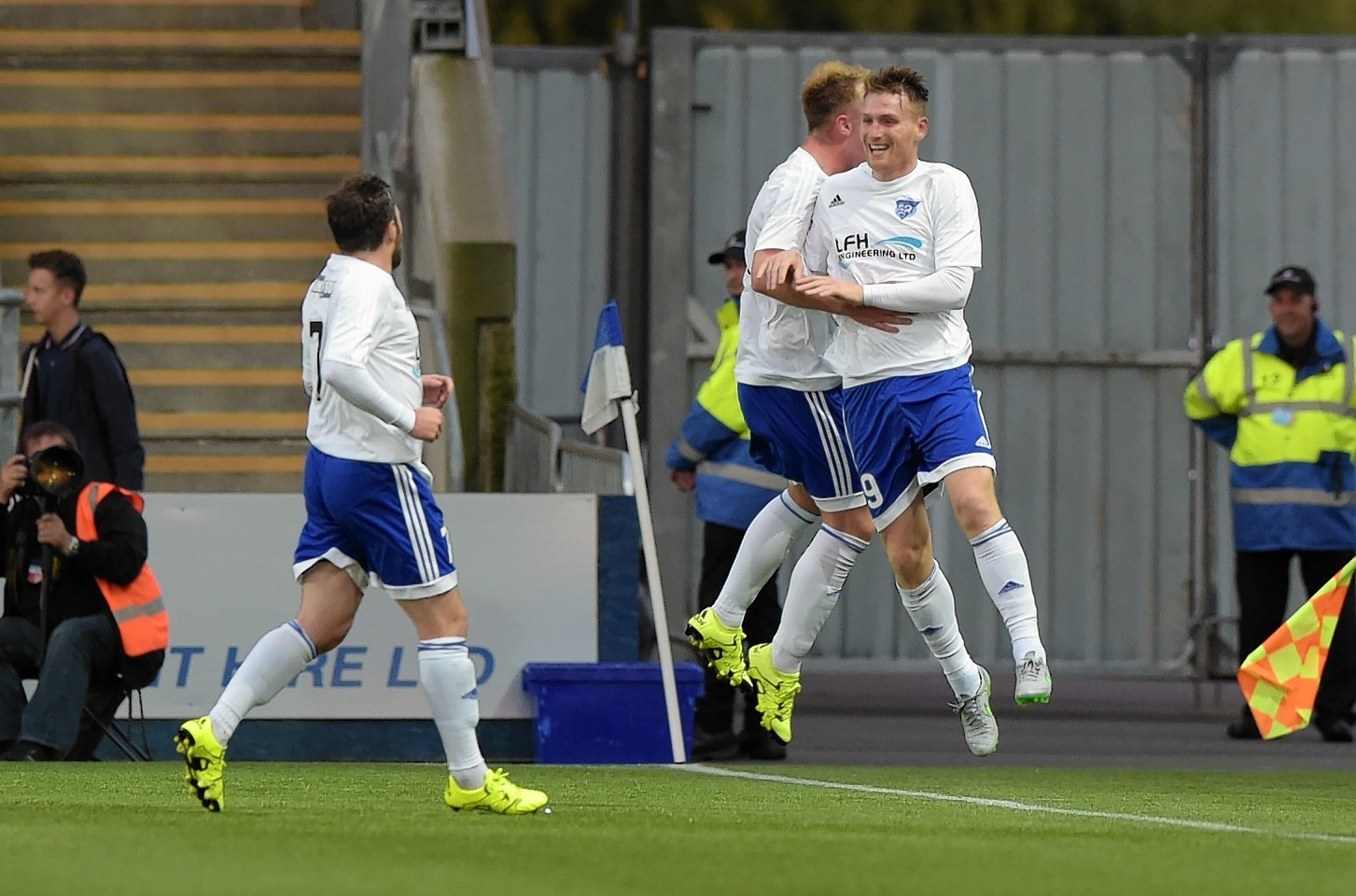McAllister (right) celebrates after grabbing his hat-trick