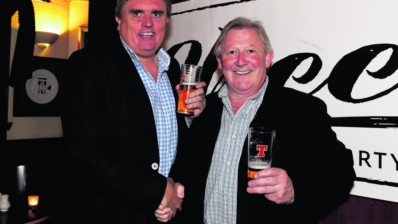 Allan Henderson, new owner and Mike Graham, previous owner.
