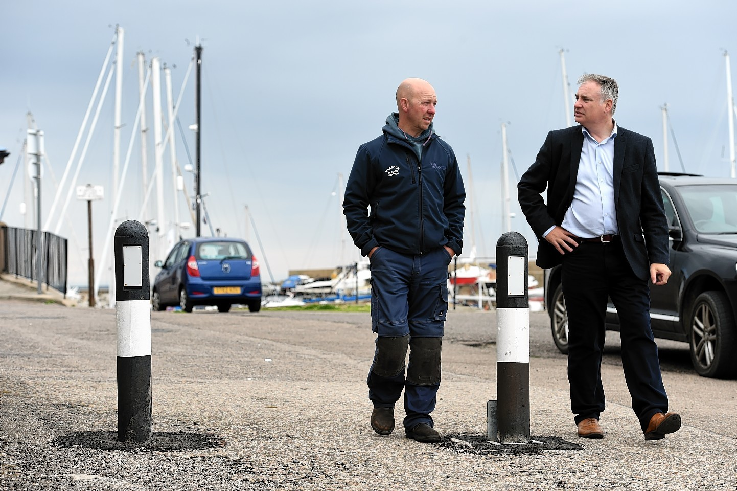 Lossiemouth garage owner, John Thomson, left, with Richard Lochhead, MSP, Picture by Gordon Lennox
