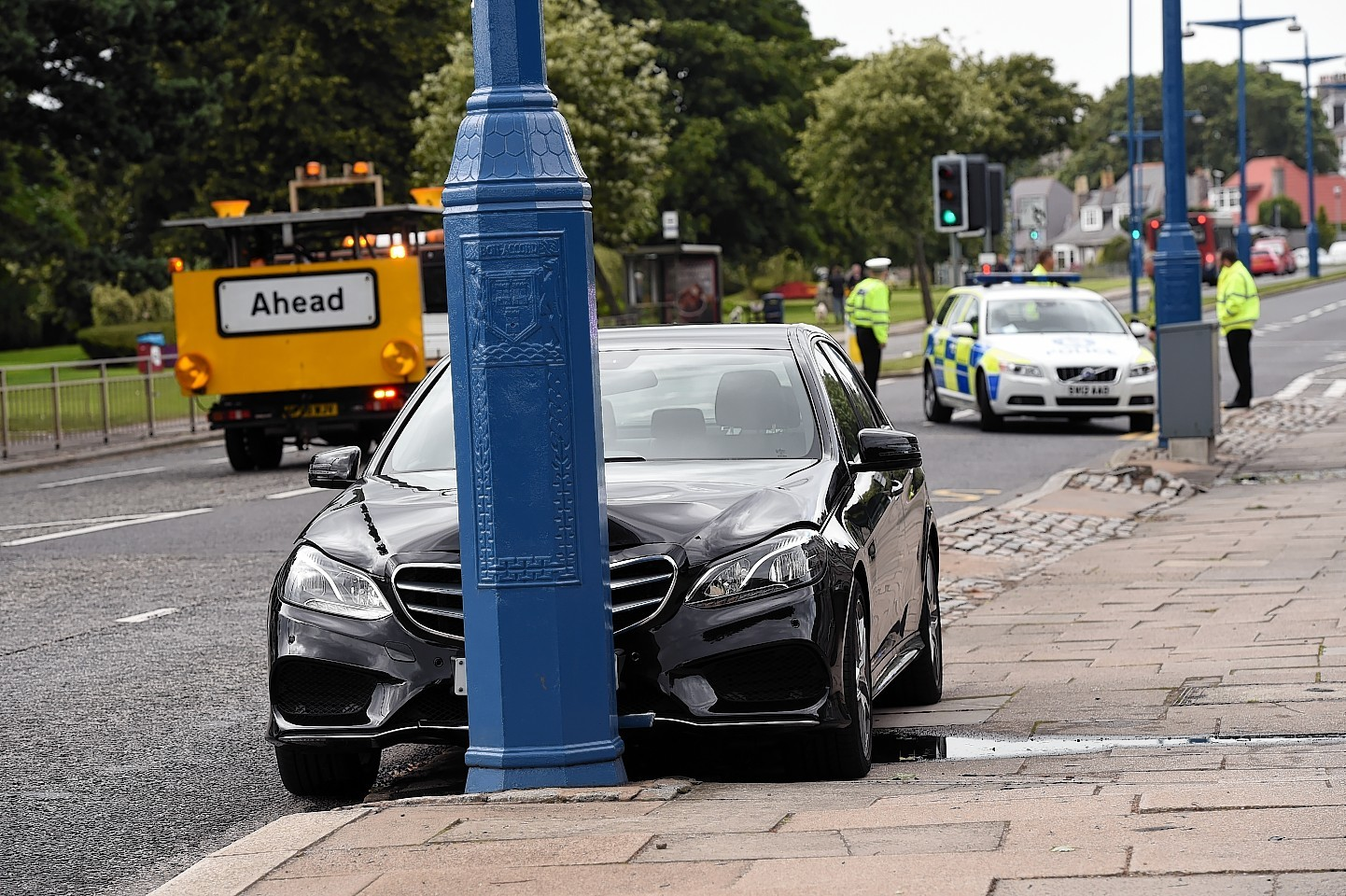 Police attend the scene of a RTC involving a Mercedes car on the B9077 Great Southern road at Murray Terrace.  Picture by KEVIN EMSLIE