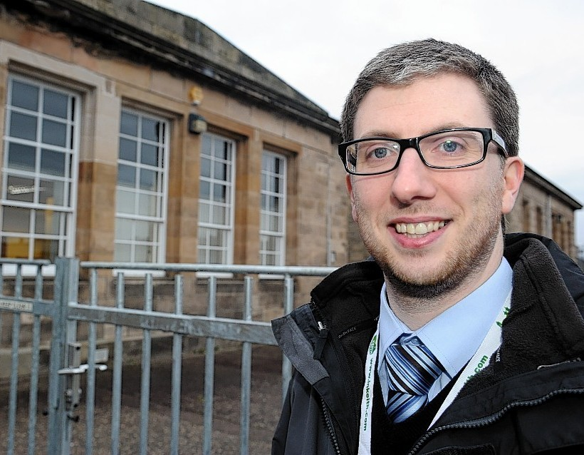 Councillor Gary Coull beside the Moray Heritage Centre, Elgin
