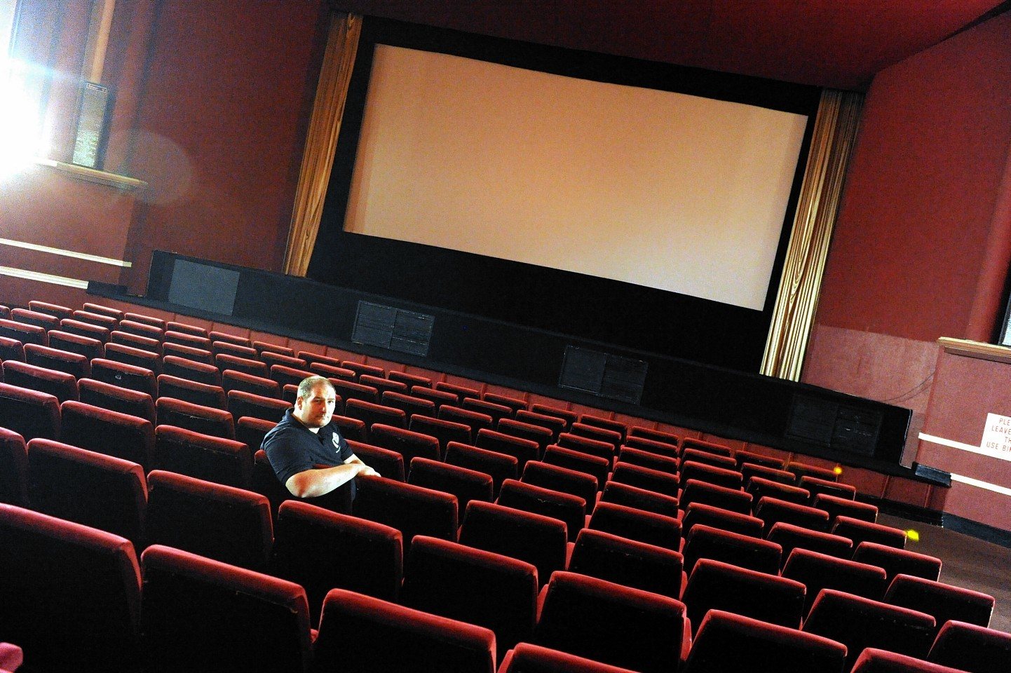 Martin Thomson, manager of the Moray Playhouse Cinema, Elgin, in the auditorium of the cinema.