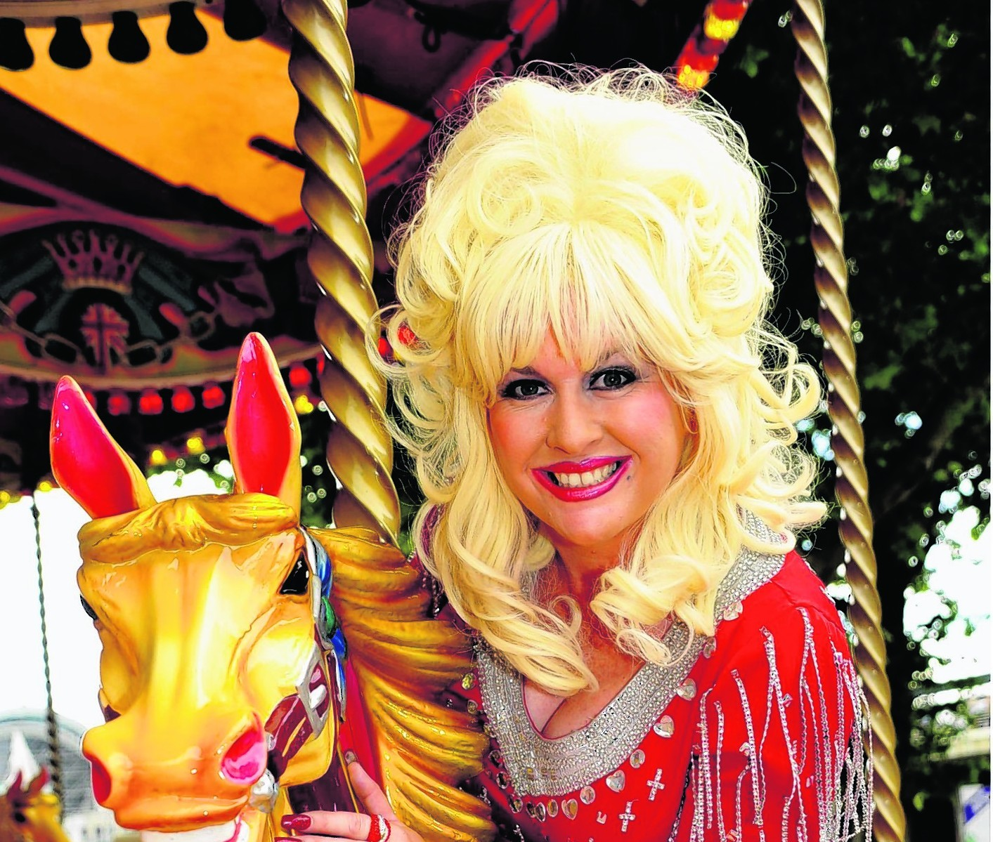 Sarah Jayne as Dolly Parton