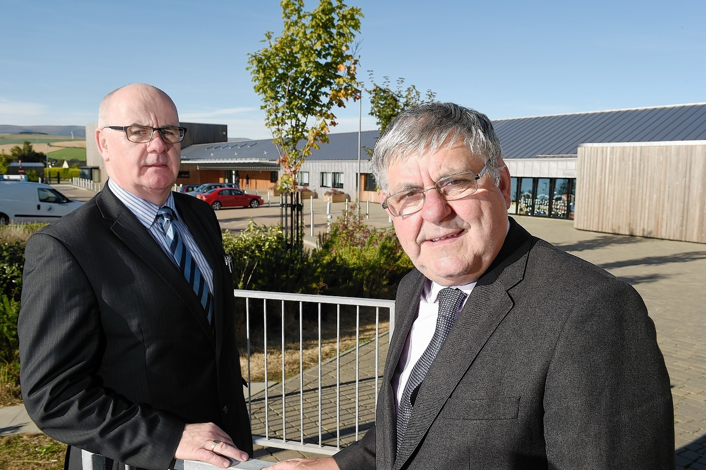 Councillors Alister Mackinnon and Graham MacKenzie outside the school yesterday