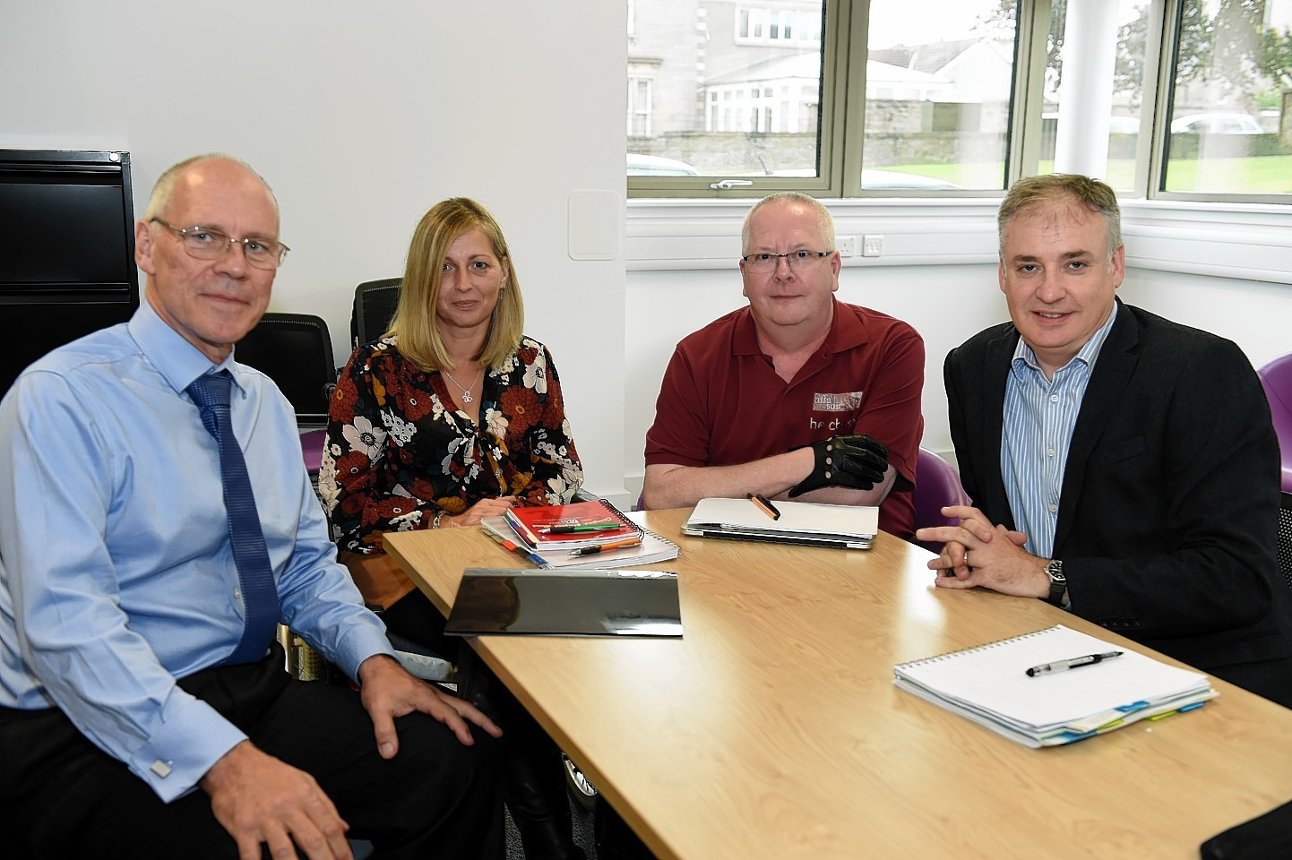 Professor Alastair Chambers, consultant in pain medicine NHS Grampian, Jeni Jeynes, Chris Bridgeford, members of 'Affasair', and MSP Richard Lochhead, who held a meeting in the Alexander Graham Bell building at Moray College to discuss the reinstatement of a pain clinic in Elgin. Picture by Gordon Lennox