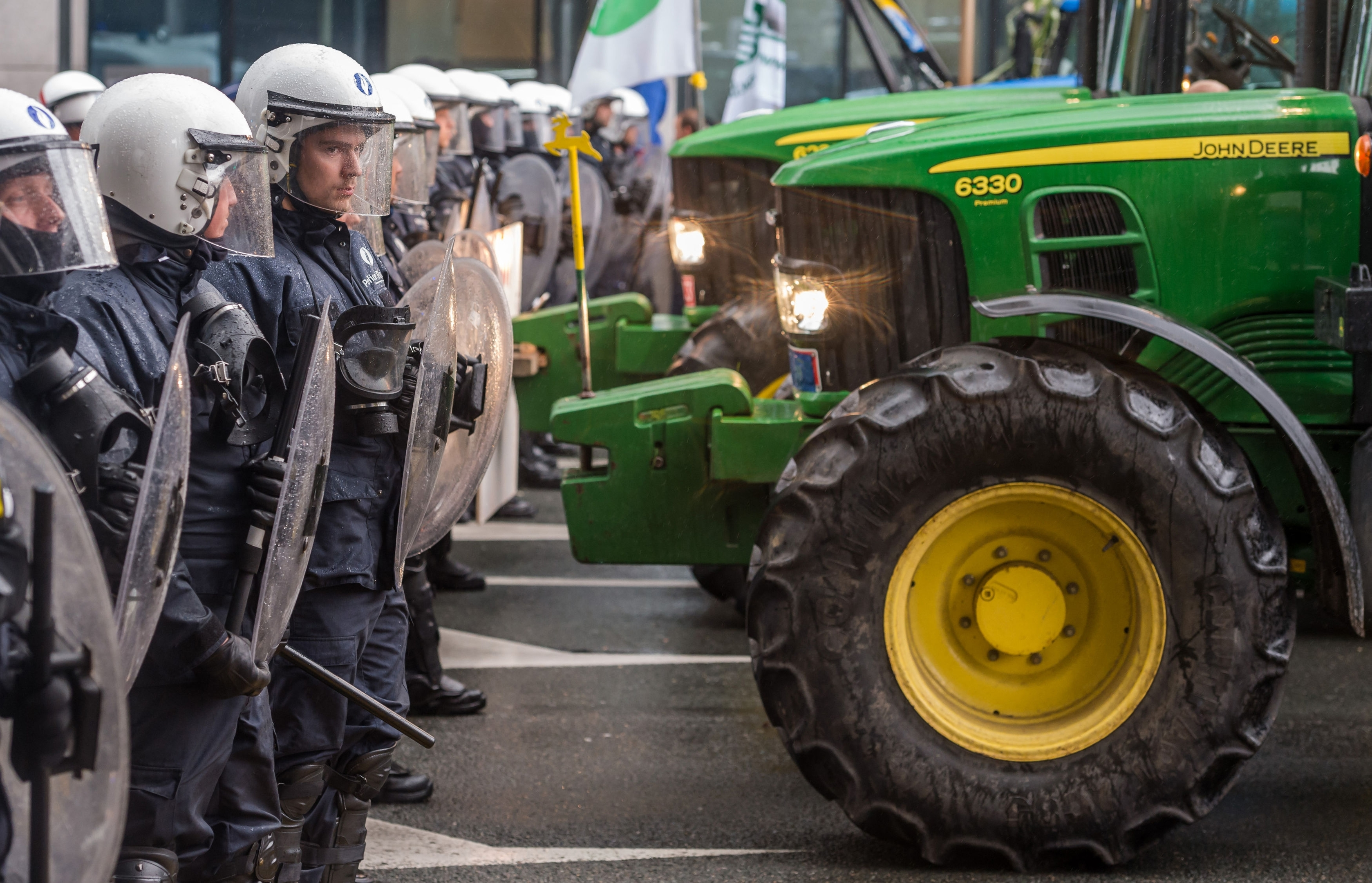 Police officers face off with farmers