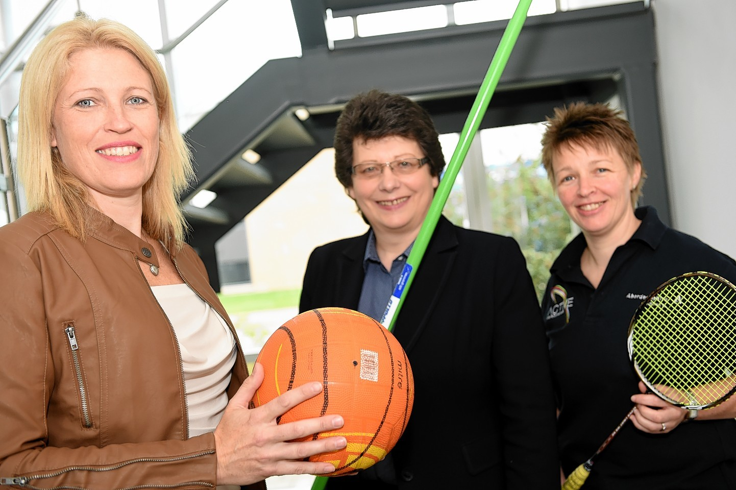 Kathryn Evans, who has been appointed as Project Manager, Moray Sports Centre, with Ann Rossiter, chairwoman of Sport Moray, and Angela Bell, Badminton Coach. Picture by Gordon Lennox