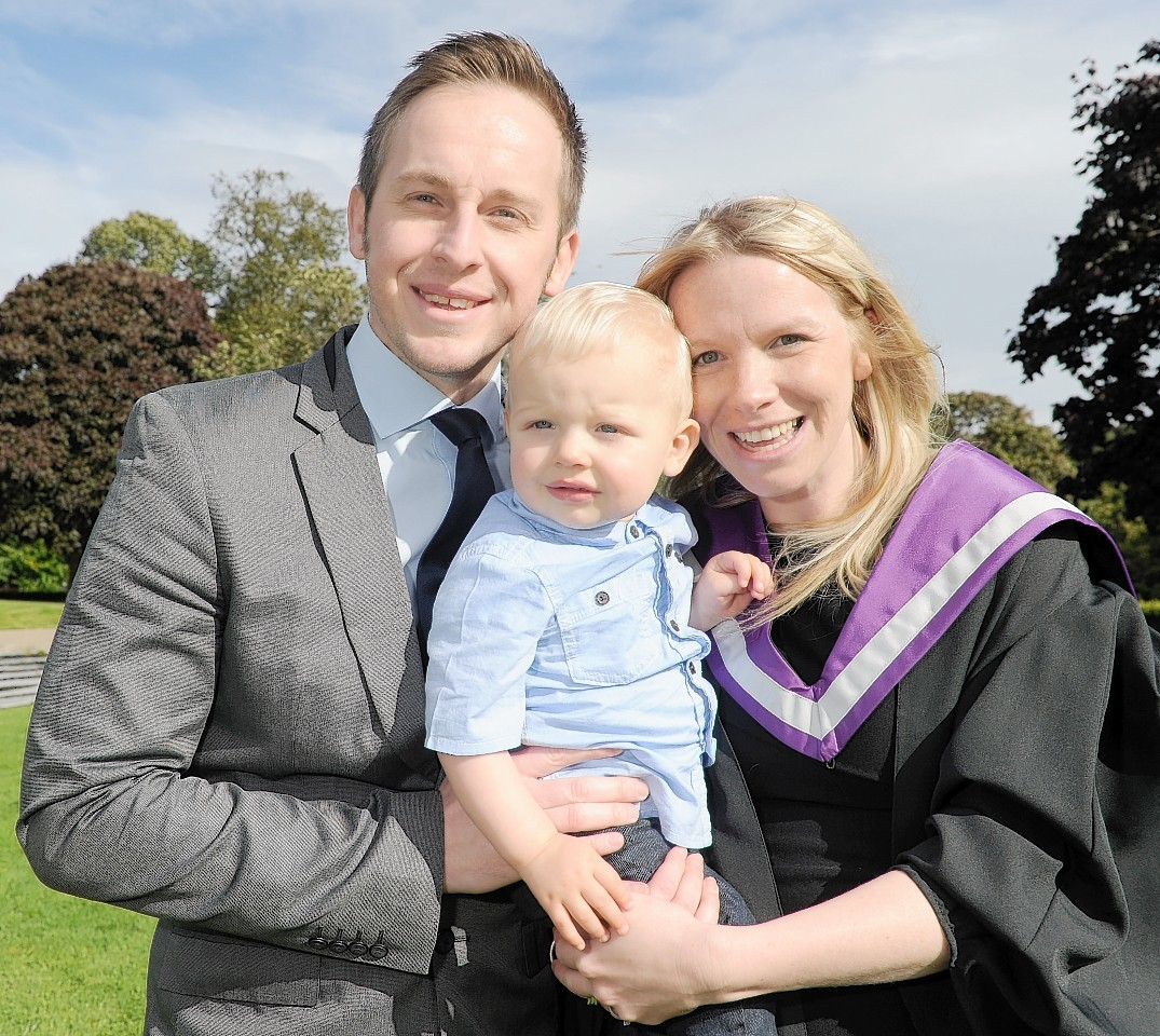 Graduate Michelle Smith, 33, with husband Richard, 33, and their 14-month old son, Finlay.