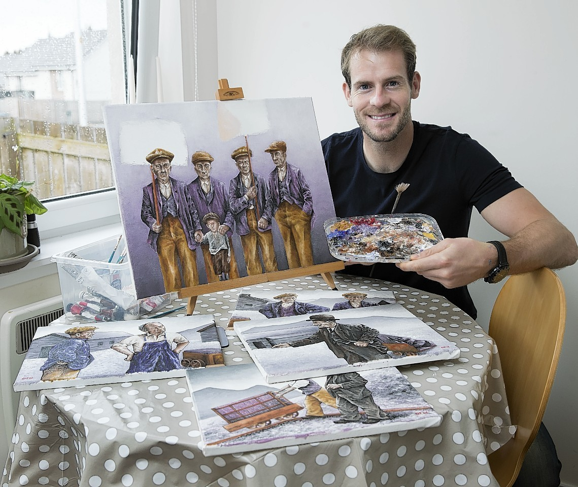 Owain Fon Williams  shows off some of his work