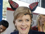 Nicola Sturgeon puts on an electroencephalogram with tartan ears during a visit to the Prince's Trust in Glasgow