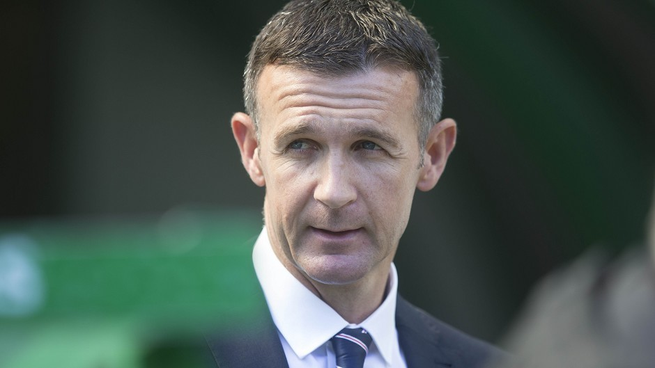 Jim McIntyre says he is happy at Ross County, after being linked with the Dundee United job.