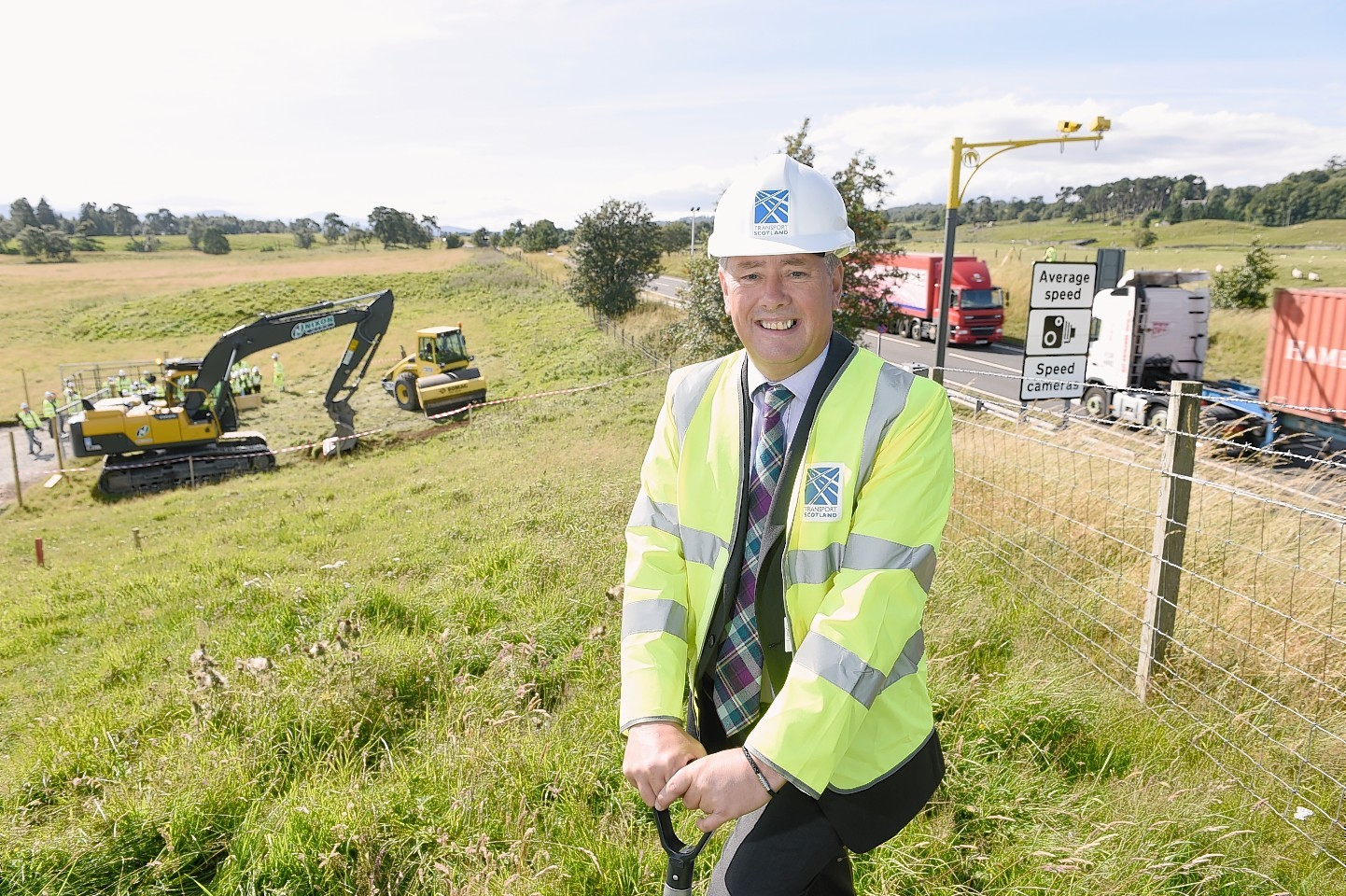Scottish Government Minister Keith Brown at Kincraig to mark the start of work on dualling, the first section opened yesterday