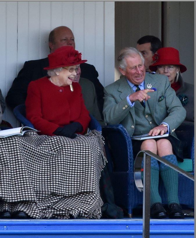 Her Majesty enjoys a joke with Prince Charles