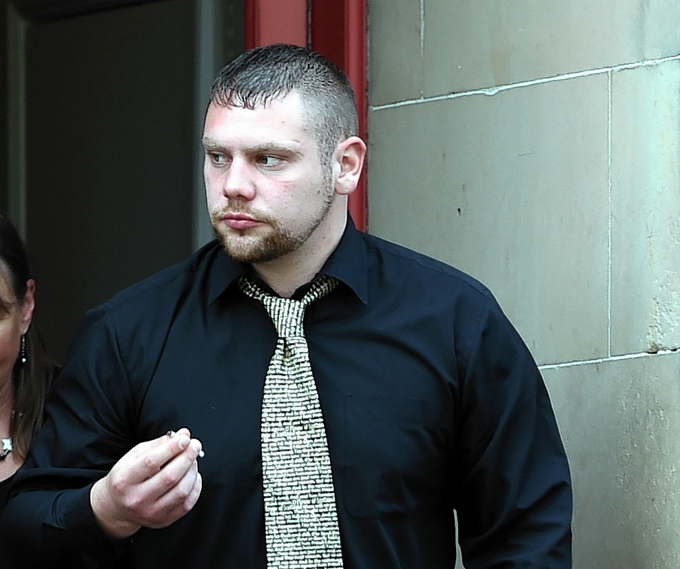 Ruaraidh McKenzie leaving Elgin Sheriff Court