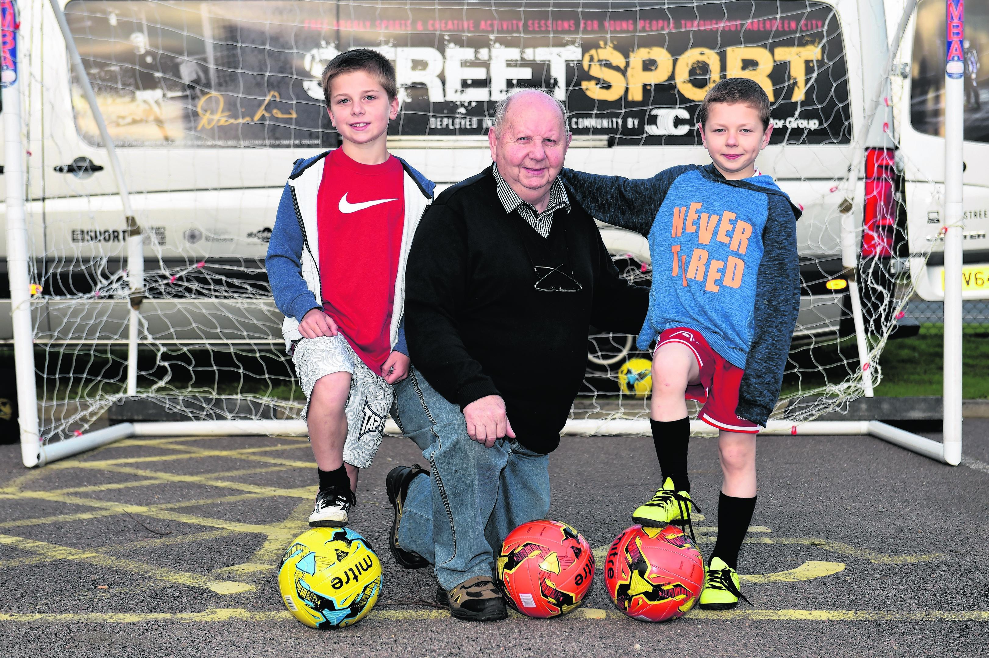 (L-R) Kooper Richardson, 9, Bill Massie and Maxwell Richardson, 8.