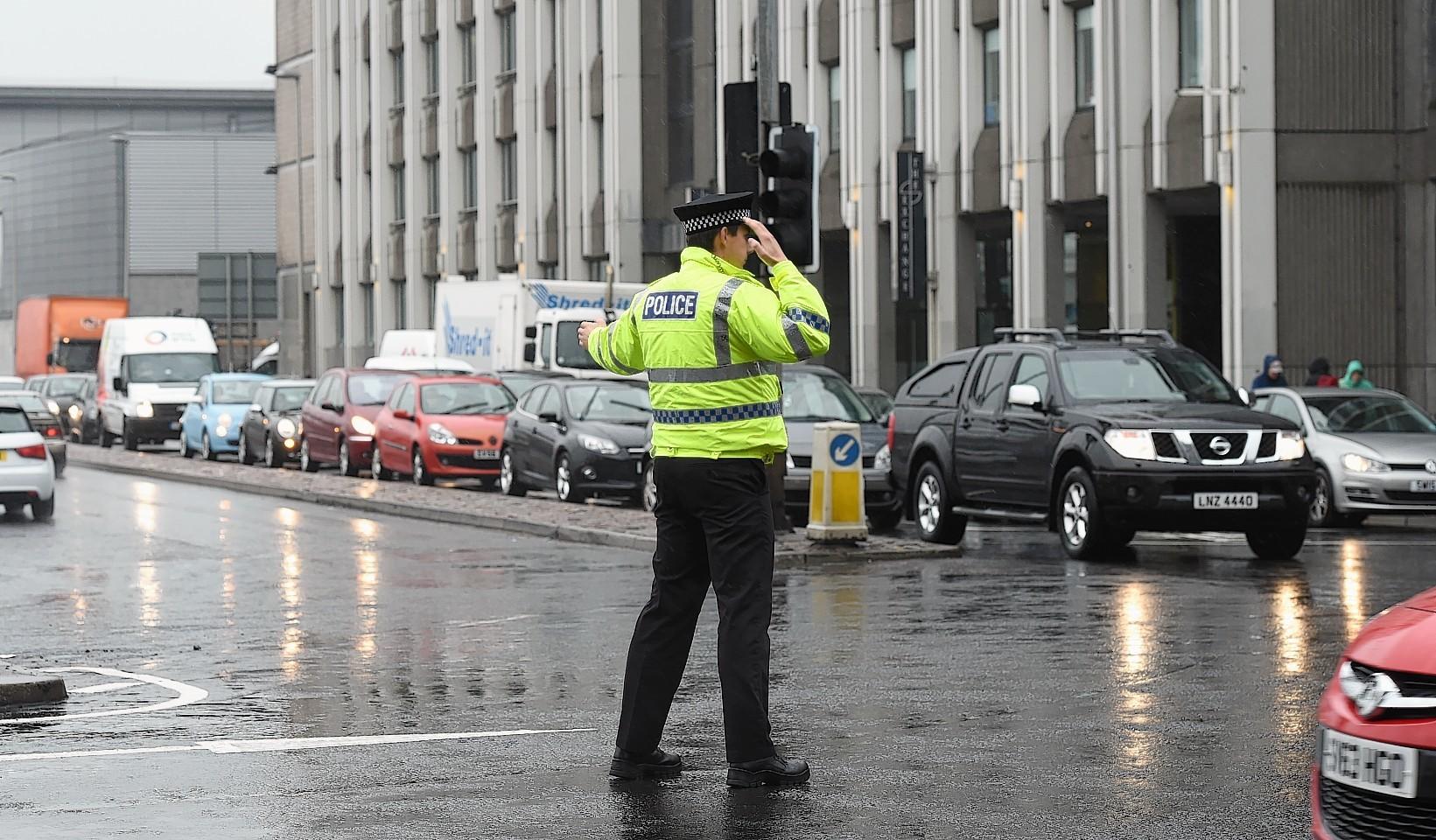 Police on Guild Street in Aberdeen.