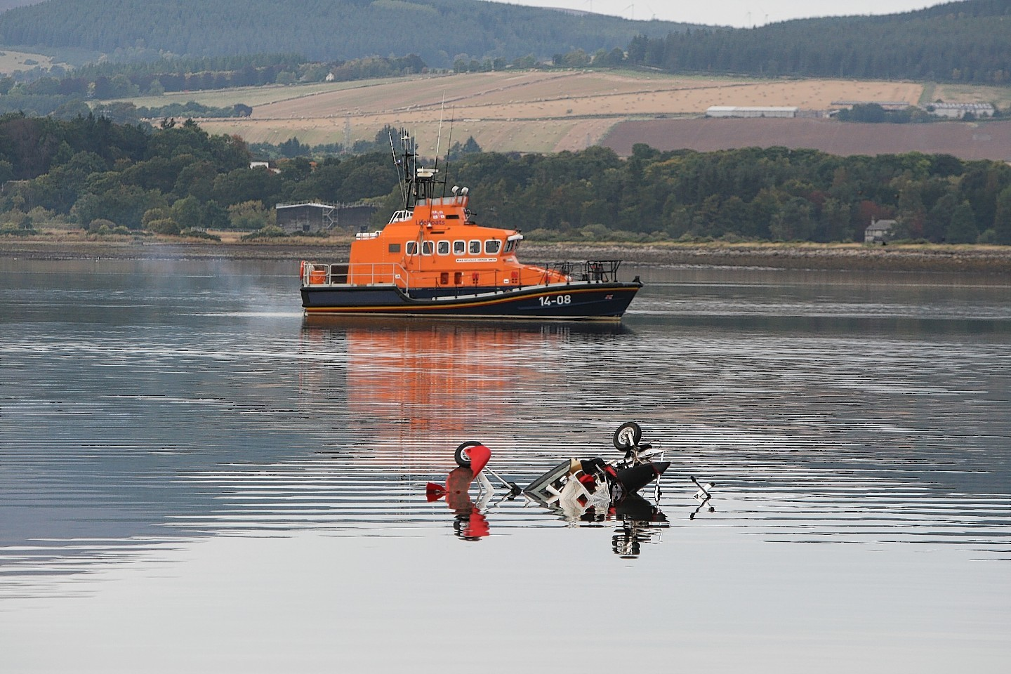 The wreckage of a microlight slowly sinking into the Cromarty Firth