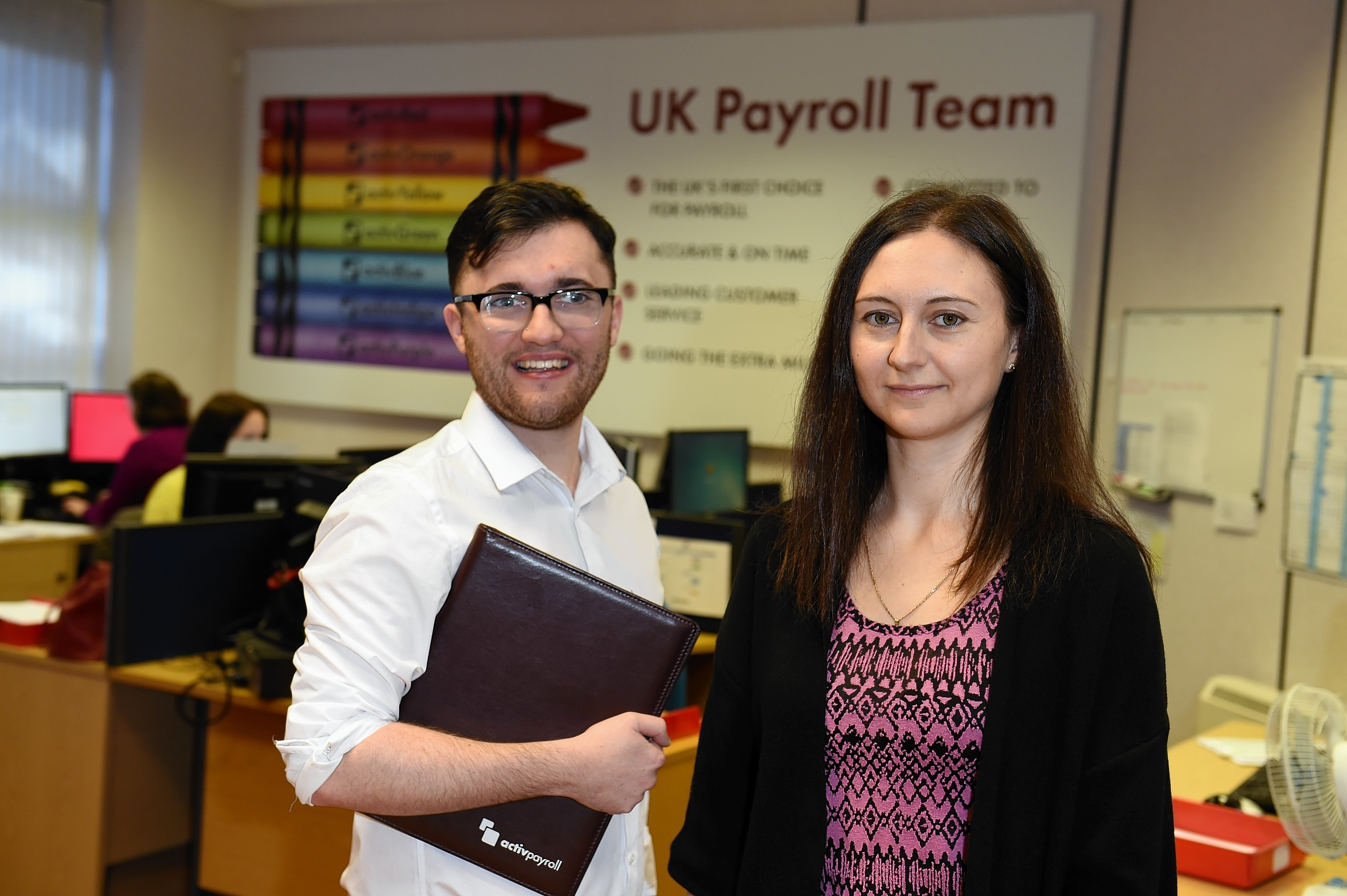 Activpayroll trainees Kyle Shand and Nellija Lincika at the company's office in Cults.  Picture by KENNY ELRICK     08/10/2015