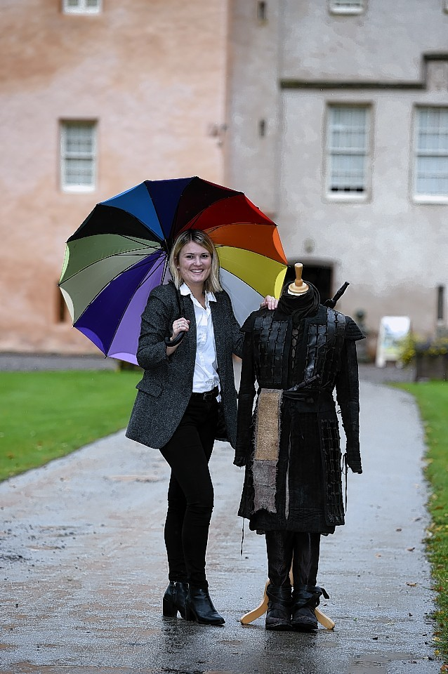 Esme Saville, assistant tourism operations manager for Moray/Speyside Tourism, with the Macbeth battle costume, at Brodie Castle.