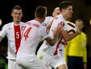 Robert Lewandowski, right, scored in injury time to end Scotland's hopes of qualifying for Euro 2016