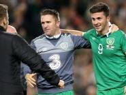 Republic of Ireland skipper Robbie Keane (left) congratulates match-winner Shane Long