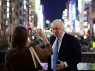 Boris Johnson poses for a photograph in Osaka, Japan