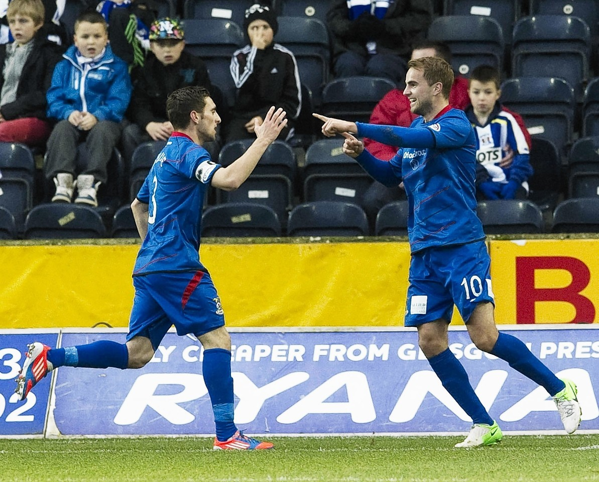 Graeme and Andrew Shinnie in action for Inverness Caley Thistle.