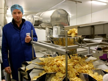 Tom Keogh in the crisps factory