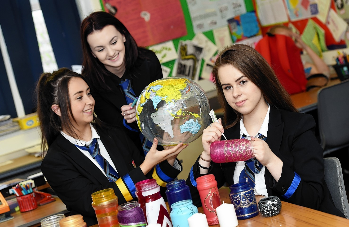 (from left) Torry Academy pupils Natalie Clark, Rachael Robertson and Kaja Malinowska working on lanterns for a Moroccan themed night to raise funds for the school's first World Challenge.