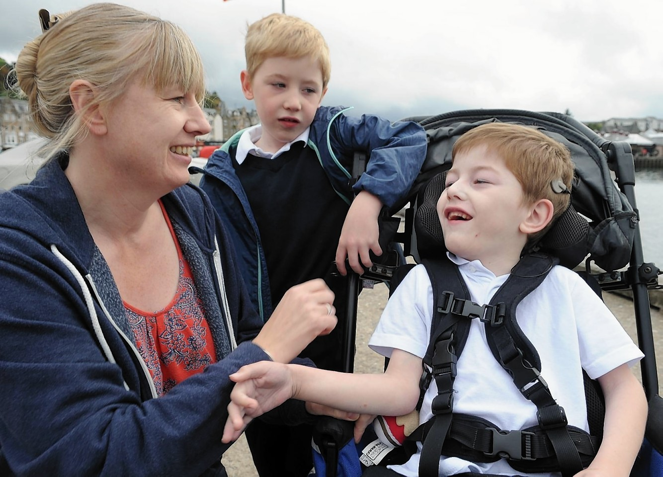 Oban mum Sandra Bruce with her two disabled children Callan and Finlay, seated, who will suffer with the withdrawal of services.