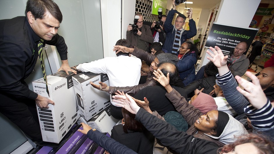 Shoppers in London get involved in the Black Friday rush