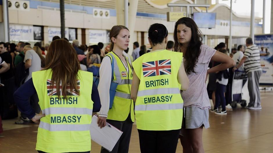British Embassy staff talk to tourists at Sharm el-Sheikh International Airport (AP)