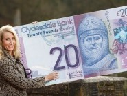 Debbie Crosbie, the chief operating officer of the Clydesdale Bank, with the first first ever Scottish banknotes to be signed by a woman